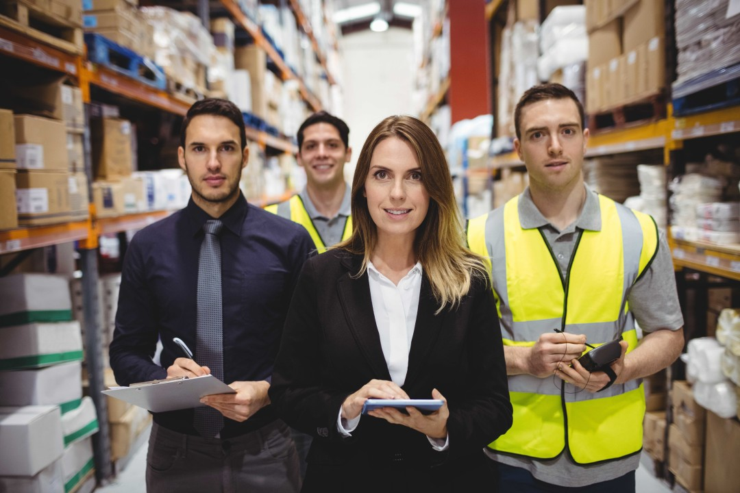 Portrait of warehouse manager and workers